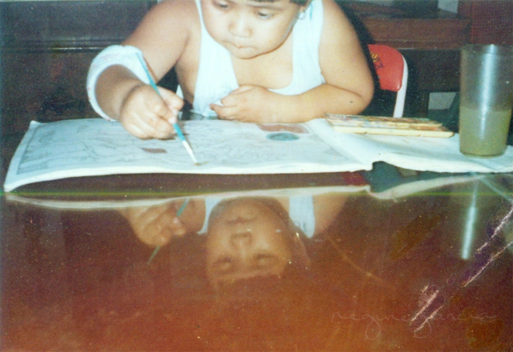 "The 6-year-old Regine Garcia playing with her art materials and wearing an odd ""wrist band"" on her elbow - haha!"