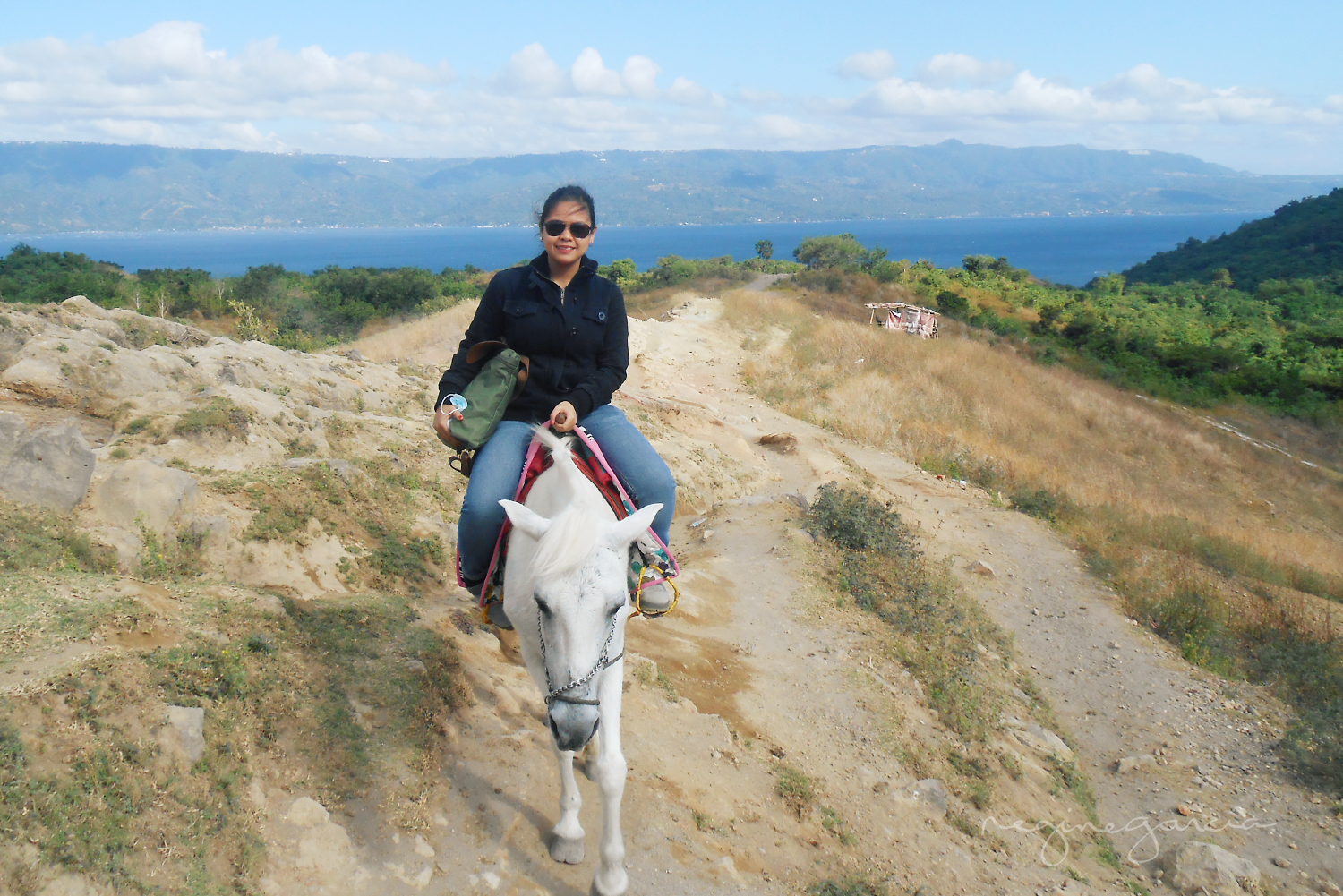 Nurturing that instant relationship of a woman and a horse - so natural, so magical. (On a steep terrain towards the crater)